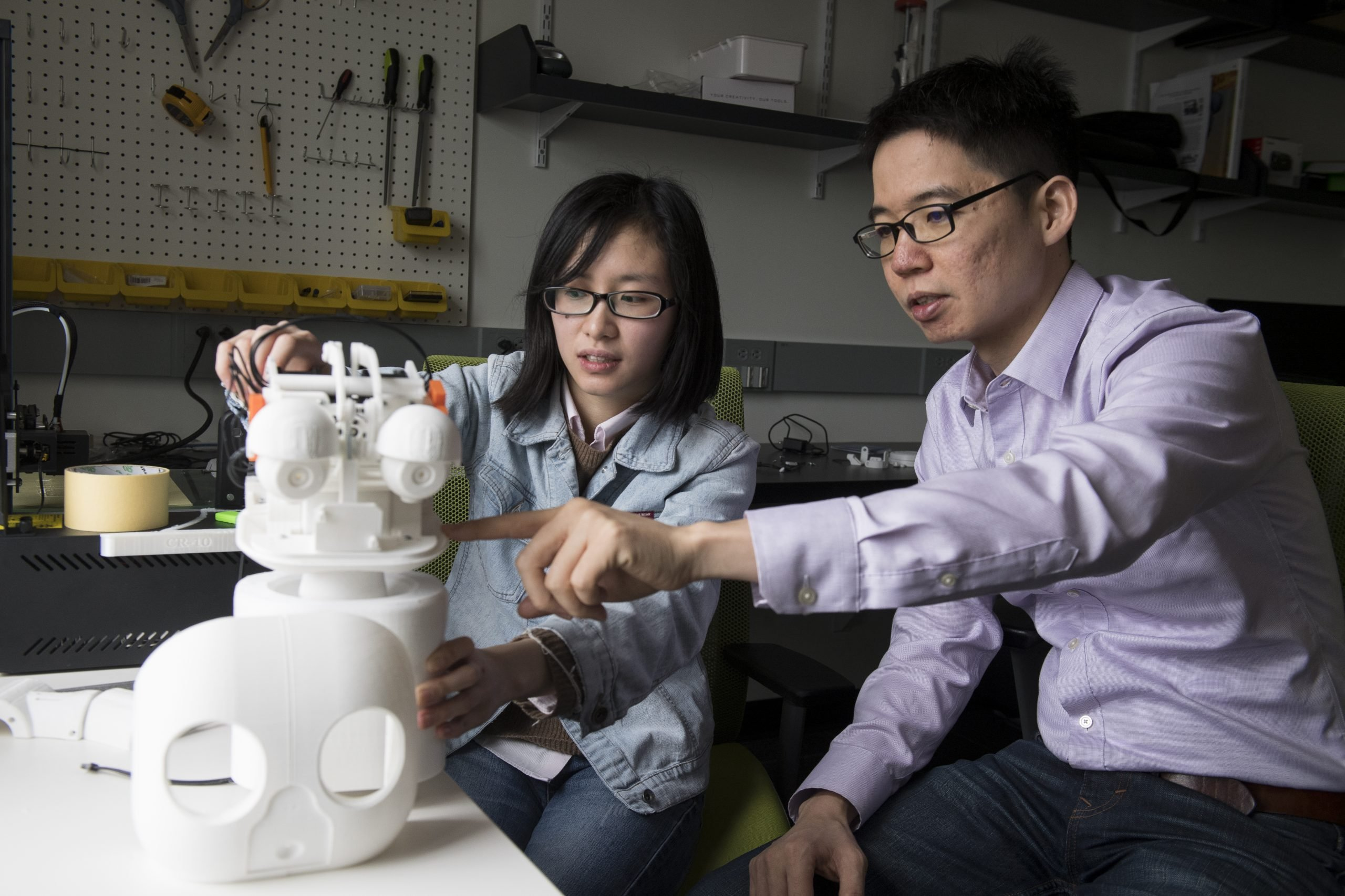 Chien-Ming Huang and student working on robot prototype