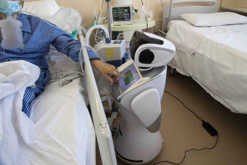 A robot tends to a COVID-19 patient in the intensive care unit of an Italian hospital